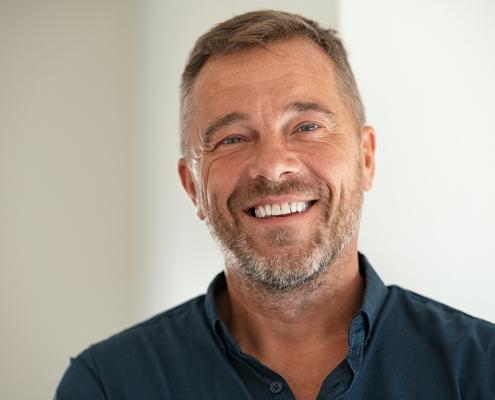 Portrait of happy mature man smiling